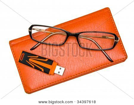 Notebook, Glasses And Pendrive Isolated On White