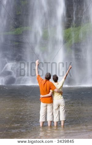 Couple In Front Of A Tropical Waterfall