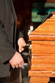 image of pallbearer  - Funeral with coffin on a cemetery - JPG