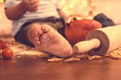 The Foot Of A Young Child In The Kitchen. The Concept Of Baby Food, Care For Children And Their Nutr poster