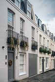 London Street Of Terraced Houses Without Parked Cars. Exclusive Mews With Colored Small Houses In Ch poster