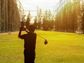 Silhouette Shot At The Back Of Old Man Practice Playing Golf After Retirement In The Morning With Wa poster