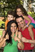 foto of family fun  - Beautiful family enjoying together in the park - JPG