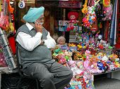 Man in turban using cellphone