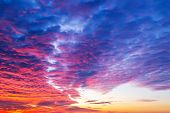 Sunset Fire In The Sky. Dark Blue Clouds With Red Reflections Of The Setting Sun. Scenic Sundown Clo poster