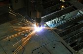 Metal Cutting. The Process Of Cutting Metal Using Plasma Cutting. poster