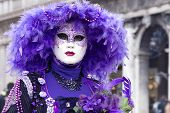 Woman In Venetian Carnival Outfit In The City Street. Purple Color. Mardi Gras. Traditional Carnival poster