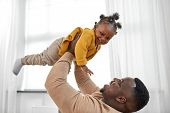 family, fatherhood and people concept - happy african american father playing with baby daughter at  poster