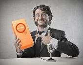 stock photo of crazy face  - Smiling salesman advertising a product - JPG