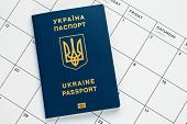 Ukrainian Biometric Passport On White Page Of Calendar. Planning Vacation Concept. International Blu poster