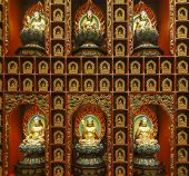 Scenery Inside Of A Buddha Temple Showing Lots Of Buddha Sculptures Seen In In Singapore poster