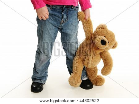 Toddler Holding Hands With A Teddy Bear
