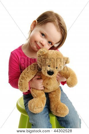 Sweet Girl Holding A Teddy Bear