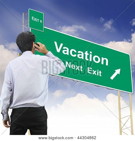 Road Sign Concept With The Text Vacation
