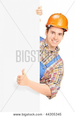Construction worker posing and giving thumb up on a panel isolated against white background