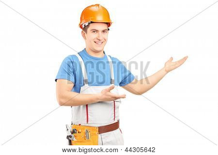A manual worker with tool belt and helmet gesturing isolated on white background