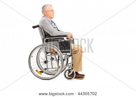 A disabled senior gentleman posing in a wheelchair isolated on white background