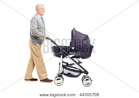 Full length portrait of a grandfather pushing his baby nephew in a stroller isolated on white background