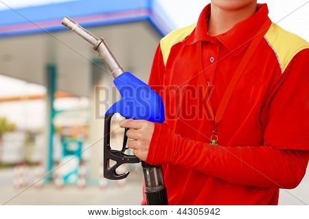 Service Station Worker In Gas Station
