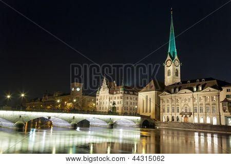 Fraumunster Church and River Limmat in Zurich at night, Switzerland