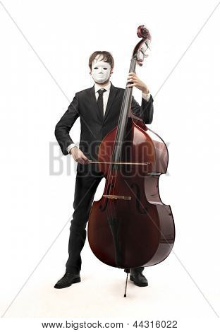 man with mask playing contrabass