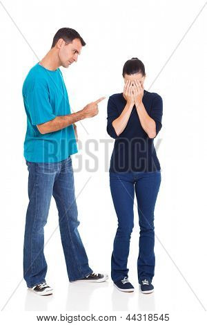 angry boyfriend pointing his crying girlfriend over white background