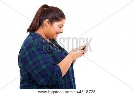 cheerful obese teenage girl chatting on her cell phone over white background