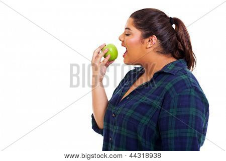close up portrait of plus size young woman eating apple on white background