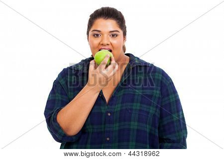 close up portrait of plus size young woman biting an apple