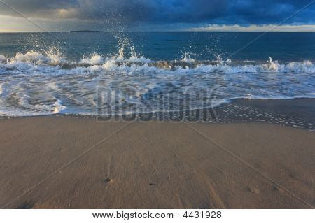 Beach With Splashing Wave Storm Clouds