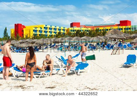 VARADERO,CUBA-APRIL 7:Tourists sunbathing at the Barcelo Solymar Hotel April 7,2013 in Varadero.With over 1 million visitors in 2012,Varadero is the preferred destination for tourists visiting Cuba