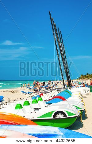 VARADERO,CUBA-APRIL 7:Recreational marina and tourists enjoying the beach April 7,2013 in Varadero.With a growth of 4.5% in 2012,tourism has consolidated as a primary source of income for Cuba