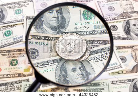 Silver dollar coin under magnifying glass