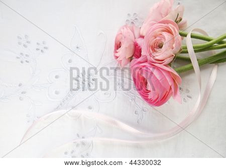 pink spring flowers on eyelet with ribbon