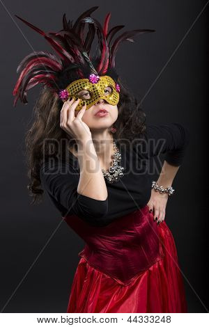 Young Romany Woman Posing On Carnaval With Mask