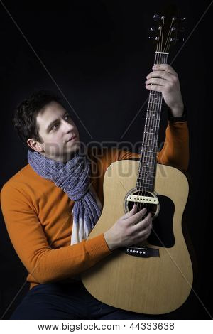 Man On Background Play Guitar