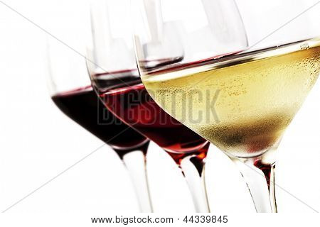 Three wine glasses over white background.  White wine, rose, and red.