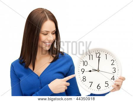 attractive businesswoman pointing her finger at wall clock