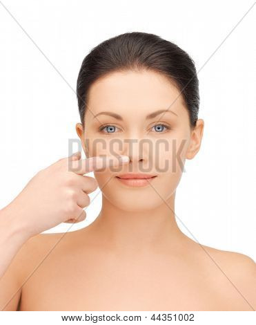 face of beautiful woman touching her nose