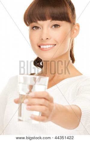 closeup of young smiling woman offering glass of water