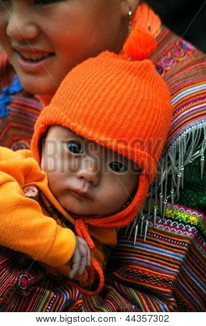 Hmong woman carrying her child in Bac Ha,Vietnam