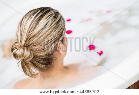 Woman in a spa taking a foam bath