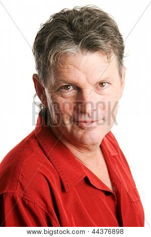 Handsome, mature man in his fifties, with a serious expression.  Isolated on white.