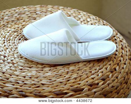 Pair Of White Bedroom Slipper On Round Stool
