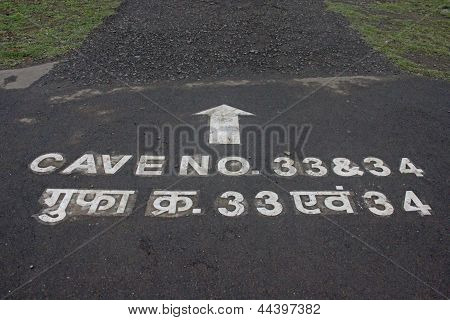 Cave No 33 & 34 written on Road at Ajantha Caves, India