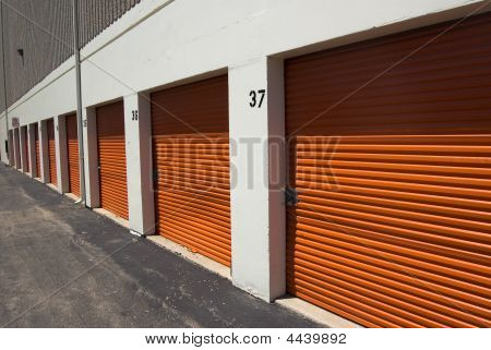 A Raw Of Orange Storage Garage Doors