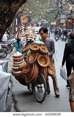 Street vendors in Hanoi selling their goods. Vietnam