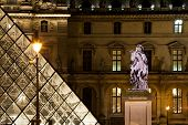 statue at Louvre courtyard in Paris