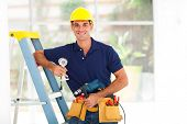 stock photo of cctv  - handsome cctv guy with tools and security camera - JPG