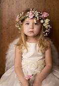 stock photo of little angel  - portrait of little girl with angel wings - JPG